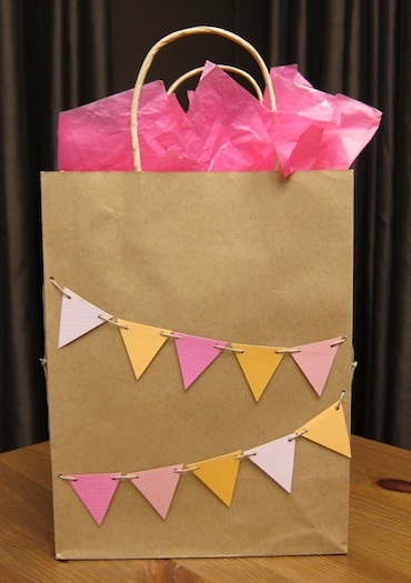 Impromptu decoration of a plain gift bag using scrap paper